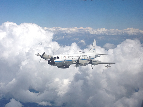 An instrumented NOAA aircraft samples the atmosphere over the southeastern United States.