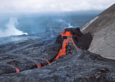 """Basaltic lava erupts from an active cone in Hawaii. This lava came from magma, but what is the definition of """"magma?"""""""