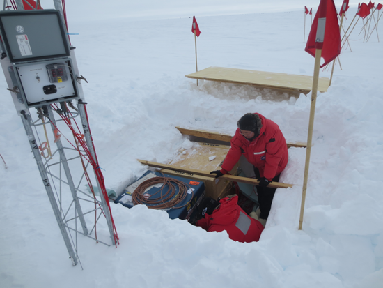 Team members work on the central pit of the AAL-PIP platform during testing near South Pole station.