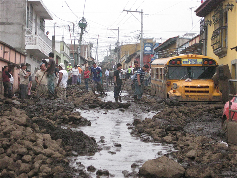 Residents clear landslide debris from the Old Town section of San Miguel Escobar, Guatemala, after Hurricane Agatha.