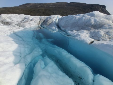 Water-filled crevasse near the calving front of Bowdoin Glacier, northwest Greenland (July 2015). Credit: Evgeny Podolskiy