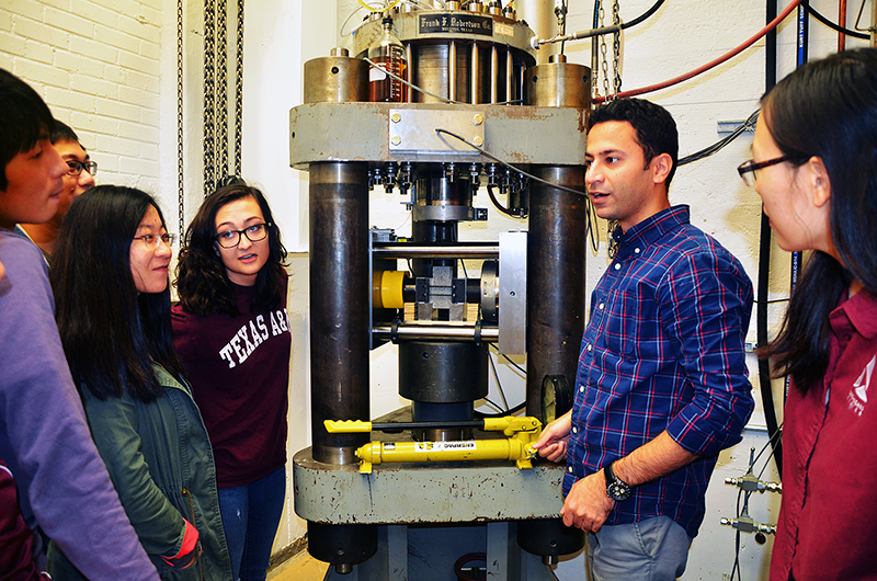 Students gather in rock deformation laboratory to learn about friction experiments.