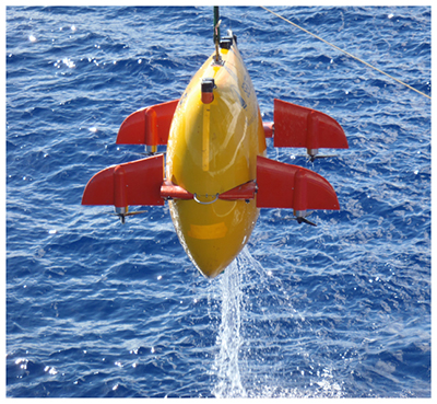 The Woods Hole Oceanographic Institute's autonomous underwater vehicle Sentry is launched from a surface ship.