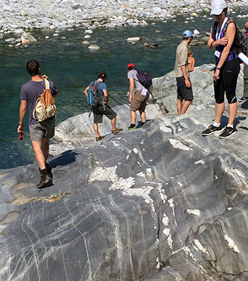 A group examines migmatitic orthogneisses along the Maggia River.
