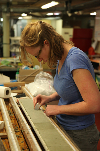 Heather Ford examines a sediment core. How will gender bias affect her scientific career?