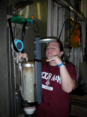 Jennifer Hertzberg inspects a sediment core on a research cruise. How will gender bias affect her scientific career?