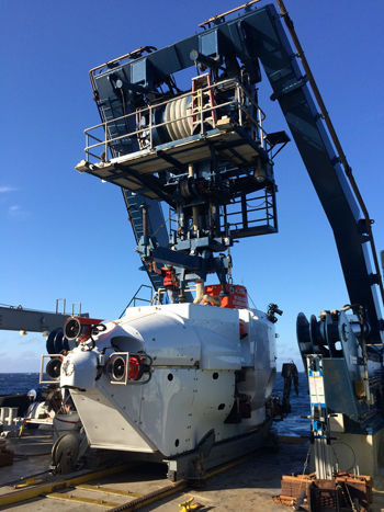 HOV Alvin, with two early-career scientists inside, awaits deployment from the aft deck of the R/V Atlantis.