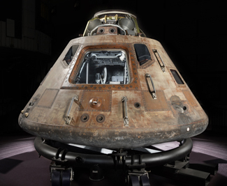 Apollo 11 command module Columbia resting on a temporary cradle.