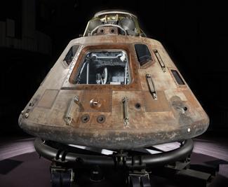 Apollo 11 command module Columbia resting on a temporary cradle.