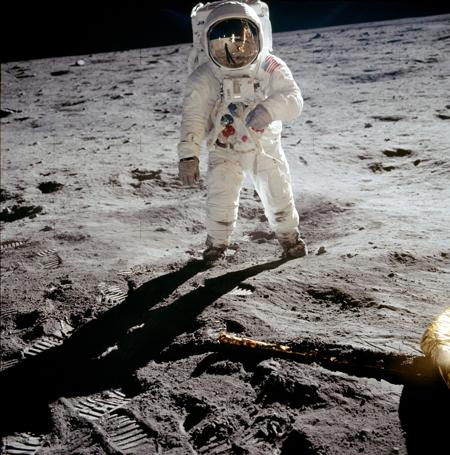 Astronaut Buzz Aldrin walks on the surface of the Moon near the leg of the lunar module Eagle.