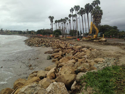 Installing large boulders as rip rap to armor the shore against further erosion at Goleta Beach in Southern California.