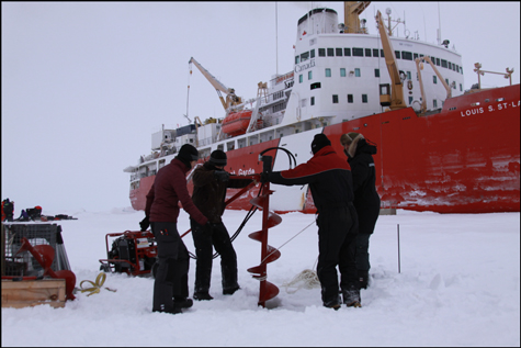 Researchers drop instruments through Arctic ice to see how ice thickness influences carbon dioxide exchange between air and sea.
