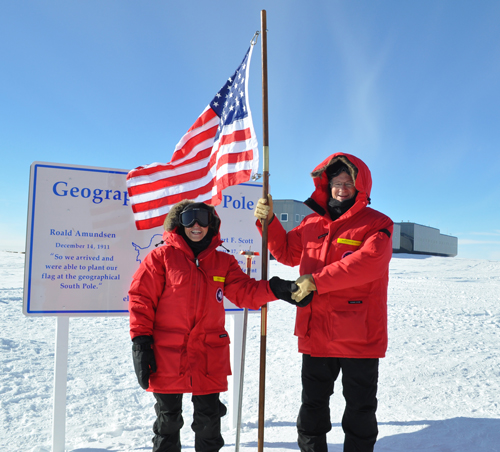 Córdova (left) is shaking hands with Committee chair Rep. Lamar Smith (R-Tx.) at the geographic South Pole during a 2014 congressional delegation visit to Antarctica.