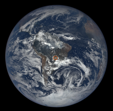 An image from the EPIC instrument aboard DSCOVR, taken on Dec. 3, 2015, shows a glint over central South America (circled in red).