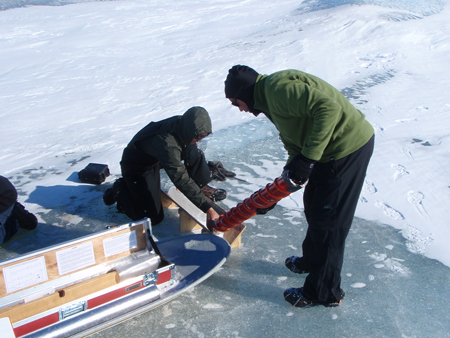 Scientists extracting a core from the ice.