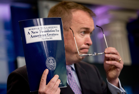 Mick Mulvaney, director of the White House Office of Management and Budget, holds up a copy of President Donald Trump's proposed fiscal year 2018 federal budget.