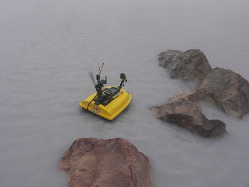 The drone boat speeds off to survey the acid crater lake Laguna Caliente, in Costa Rica's Poás volcano.