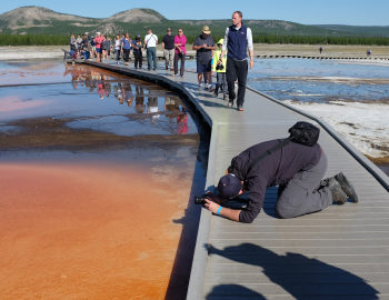DCO Summer School participants study a hot spring in Yellowstone National Park.