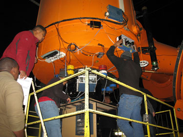 A group of researchers mount a device called the Sutherland High-speed Optical Camera (SHOC) on the 74-inch telescope at the South African Astronomical Observatory.