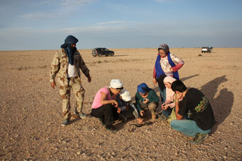 Planetary and space science researchers look for meteorites in the Sahara Desert of Morocco.