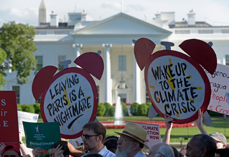 Protesters gathered outside the White House on 1 June to protest Trump's decision to withdraw the U.S. from the Paris accord.