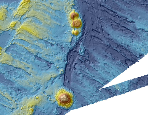 A fault in the seabed slices through a series of submarine volcanoes spotted from above by searchers looking for wreckage from lost Malaysia Airlines flight MH370.