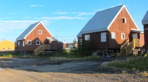Buildings in Inuvik sit about a meter or more above the ground, resting on buried stilt-like pilings or metal frameworks