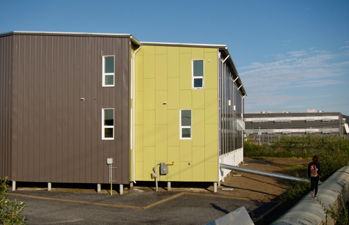 Many buildings in Inuvik and across the Arctic use traditional steel pilings as a foundation
