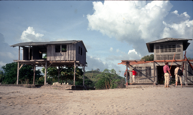 After the 1 September 1992 tsunami in Nicaragua, ITST members note the only two houses in Popoyo that survived.