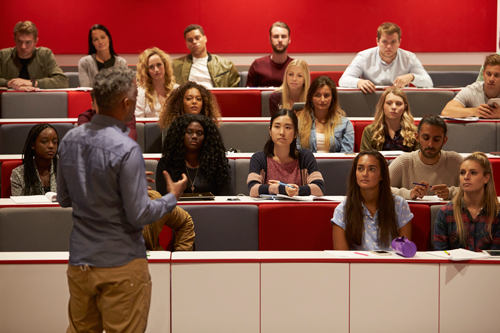 Professor lecturing to university students.