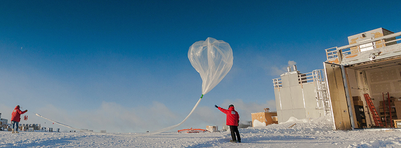 Researchers release a weather balloon carrying an ozone sonde during the 2016 ozone hole research season at the South Pole.
