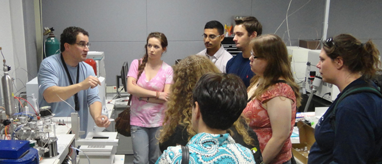 College class on a trip to a lab.