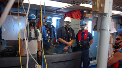 Woods Hole Oceanographic Institution researchers donned respirators to work on the top deck of R/V Endeavor