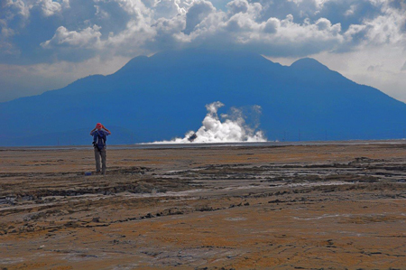 Adriano Mazzini stands on top of dried mud from the Lusi eruption.