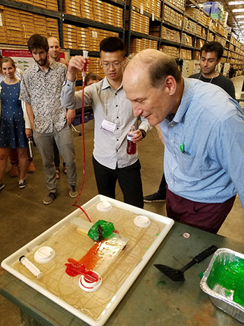 Using green gelatin and red-colored water to simulate the way magma intrusion breaks up Earth's crust