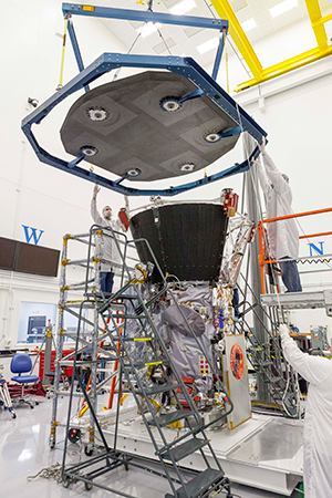 Engineers at the APL lowered the heat shield onto the Parker Solar Probe spacecraft.