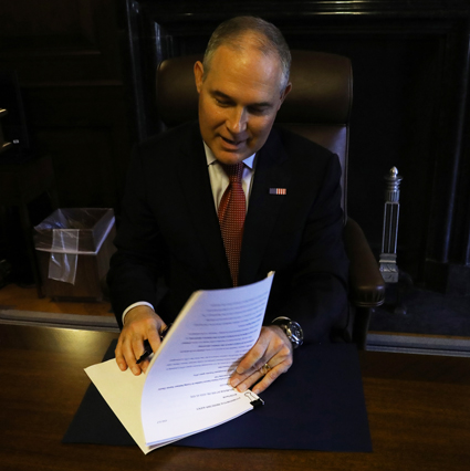EPA administrator Scott Pruitt signs the notice to propose repealing the Clean Power Plan.