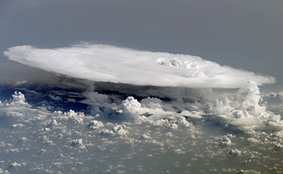 "Cumulonimbus cloud ""tower"" over Africa."