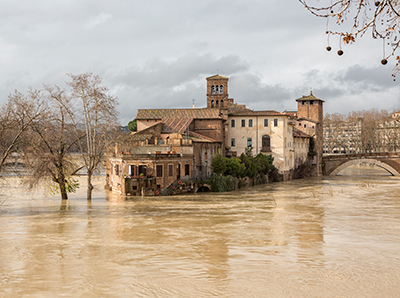 Flooded Tiber River surrounds Tiber Island in Rome, Italy.