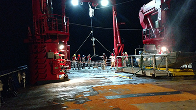 Deploying the gravity corer to sample a small mound feature on the seafloor that is associated with methane seeps.