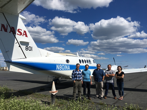 Researchers pose in front of the AirSWOT aircraft, a retrofitted King Air B200