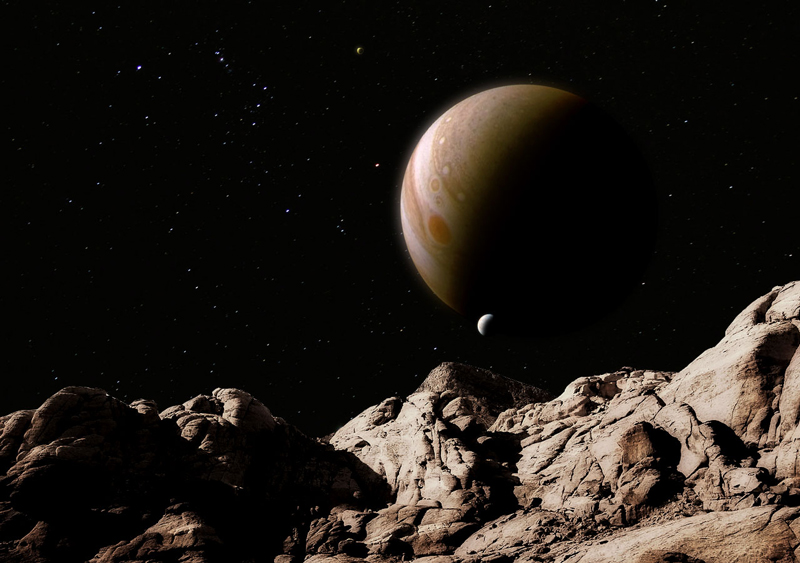 Jupiter rising over an alien landscape; a JunoCam image grafted on background stars and Red Rock Canyon.