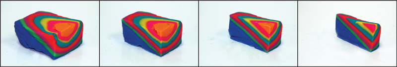 Stacked layers of modeling clay demonstrate how the interior of a 3-D structure appears on cross-sectional surfaces.