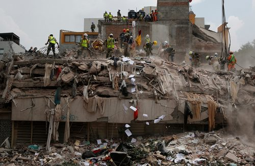 Workers in Mexico City search for survivors after a magnitude 7.1 earthquake shook on 19 September 2017.