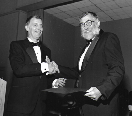 American Geophysical Union president Ralph Cicerone congratulates Joseph Walsh on being named an AGU Fellow in 1993.