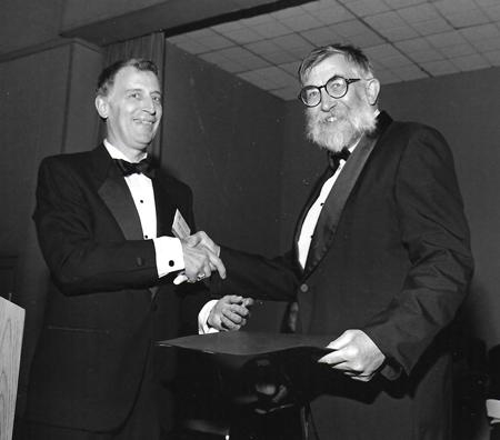 American Geophysical Union president Ralph Cicerone congratulates Joseph Walsh on being named an AGU Fellow in 1993.
