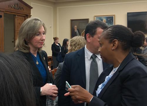 Subcommittee chairwoman Barbara Comstock (left) speaks with witness Rhonda Davis of NSF.