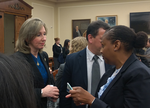 Subcommittee chairwoman Barbara Comstock (left) speaks with witness Rhonda Davis of NSF.