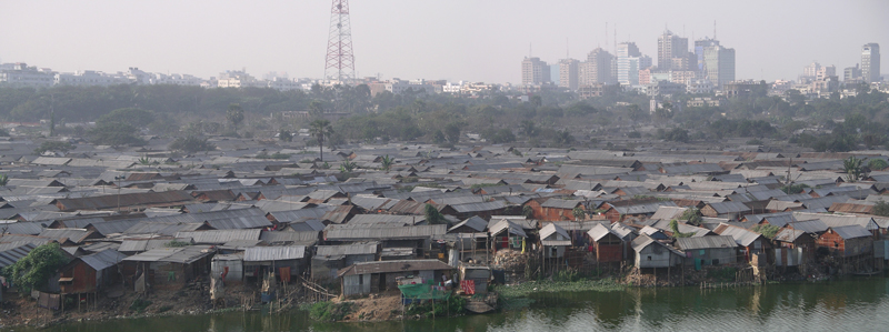 Dhaka, Bangladesh, shows the contrast between a dense waterfront neighborhood and skyscrapers further inland.