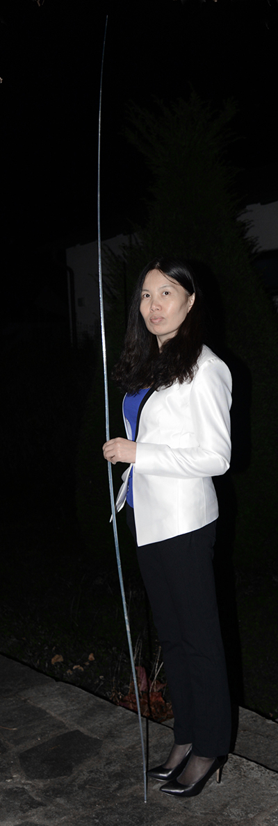 A researcher holds a 2.7-meter-long silica spicule of M. chuni obtained from a living specimen from the South China Sea.